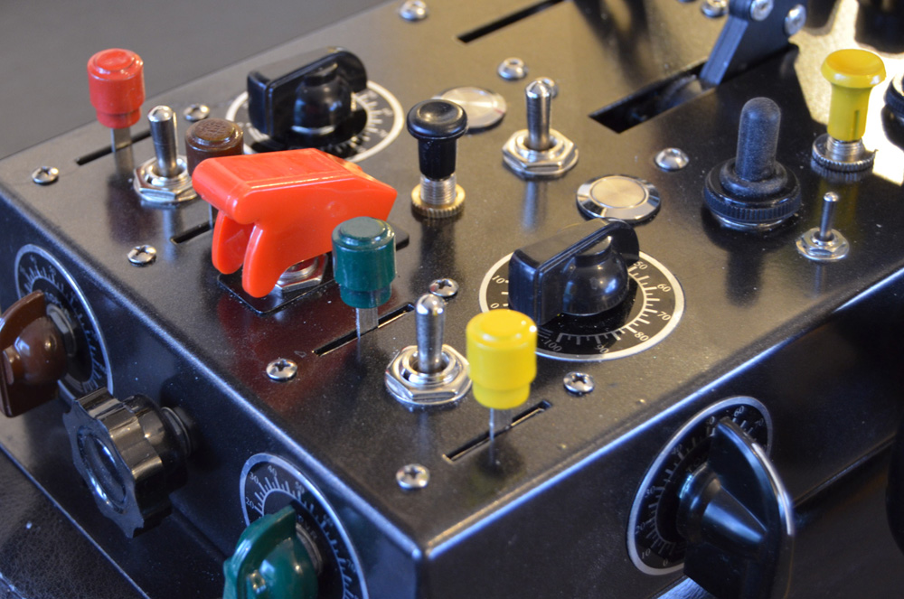 Colour coded button knobs can also be black.